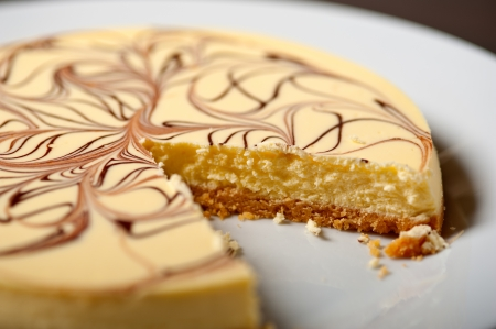fresh baked classic Cheese cake with chocolate topping  photo