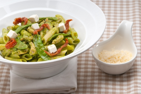 classic Italian penne pasta with sundried tomato and basil photo