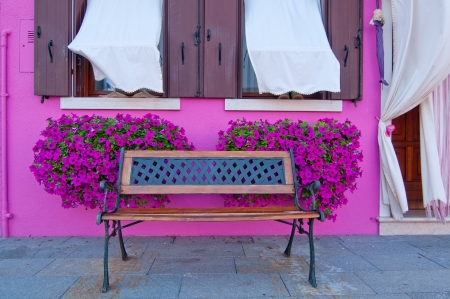 bench in front of traditional colorful houses  photo