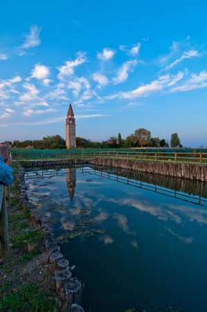 Venice Burano Mazorbo vineyard with campanile bell tower of Saint Caterina on background photo