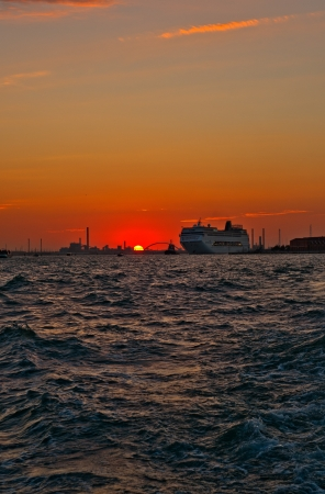 Venice Italy sunset with cruise boat very pittoresque view photo