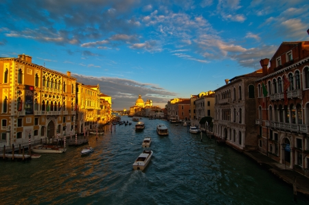 Venice Italy grand canal view from the top of Accademia bridge with Madonna della Salute church on background at sunset photo