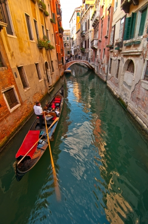 Venice Italy Gondolas on canal , most famous boat  photo