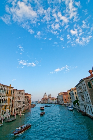 Venice Italy grand canal view from the top of Accademia bridge with Madonna della Salute church on background photo