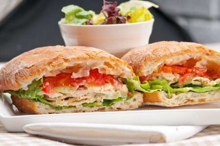 chicken sandwich: italian ciabatta panini sandwich with chicken and tomato Stock Photo