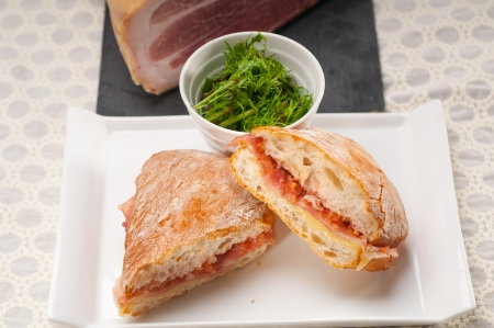 Italian ciabatta panini sandwich with parma ham and tomato photo