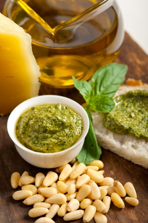 Italian basil pesto bruschetta ingredients over old wood macro photo