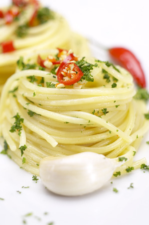 pasta garlic olive oil and red chili pepper closeup on a white dish Stock Photo