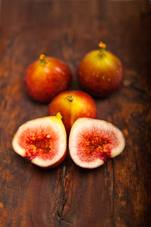 fresh figs macro closeup over old wood boards photo