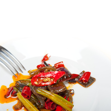 cuisines: fried chili pepper and vegetable on a iron wok pan Stock Photo