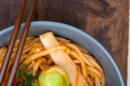 stretched: hand pulled stretched Chinese ramen noodles on a bowl with chopstick