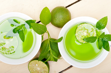 infusion: fresh and healthy mint infusion tea tisane with lime Stock Photo