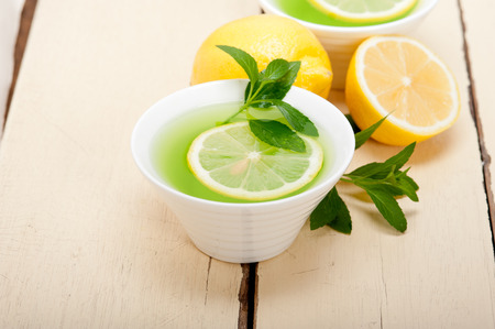 infusion: fresh and healthy mint infusion tea tisane with lemon