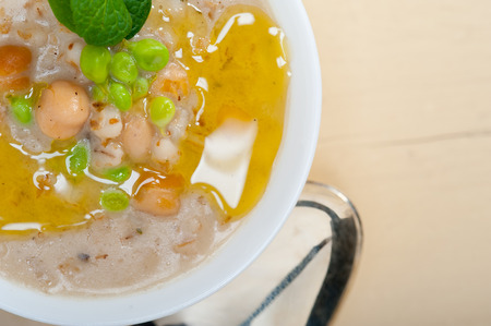 hearty: Hearty Middle Eastern Chickpea and Barley Soup with mint leaves on top