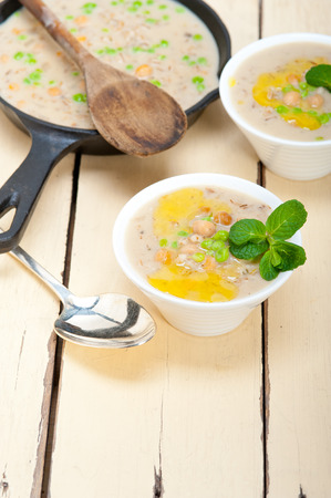 middle eastern: Hearty Middle Eastern Chickpea and Barley Soup with mint leaves on top