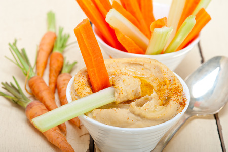 fresh hummus dip with raw carrot and celery arab middle eastent healthy food Stock Photo