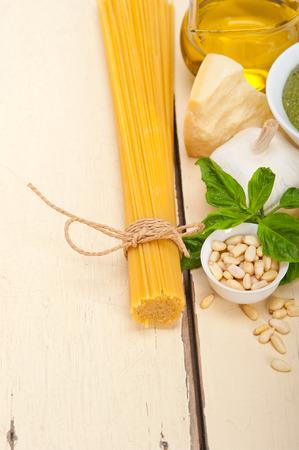 extra virgin olive oil: Italian traditional basil pesto pasta ingredients parmesan cheese pine nuts extra virgin olive oil garlic on a rustic table