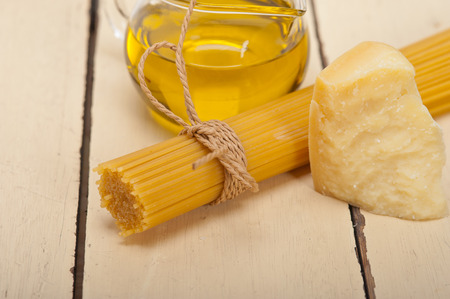 basic food: Italian pasta basic food ingredients parmesan cheese and extra virgin olive oil