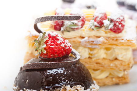 napoleon dessert: selection of fresh cream napoleon and chocolate mousse cake dessert plate