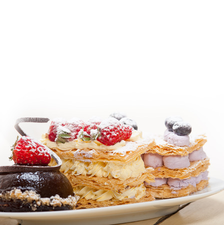 napoleon dessert: selection of fresh cream napoleon and chocolate mousse cake dessert plate