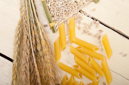 short pasta: short Italian pasta penne with durum wheat grains Stock Photo