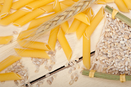 durum: short Italian pasta penne with durum wheat grains Stock Photo