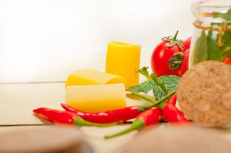 maccheroni: Italian pasta paccheri or schiaffoni with tomato mint and chili pepper ingredients