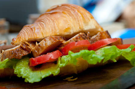 savory croissant brioche bread with chicken and vegetable rustic style Stock Photo