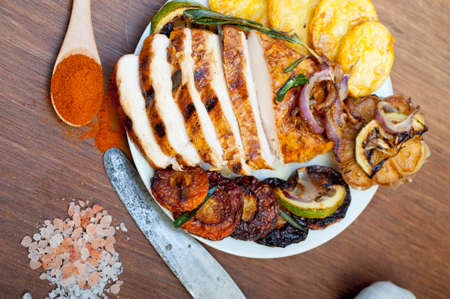 roasted grilled BBQ chicken breast with herbs and spices rustic style Reklamní fotografie