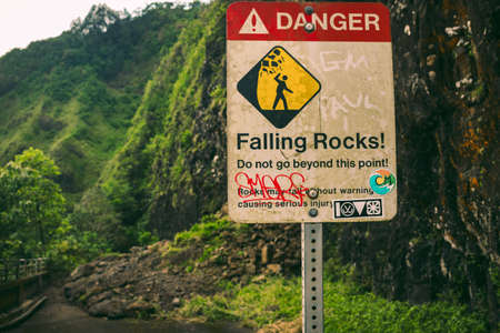 A warning sign posted because of a rockslide on a hike off the side a hike in Hawaii. Reklamní fotografie