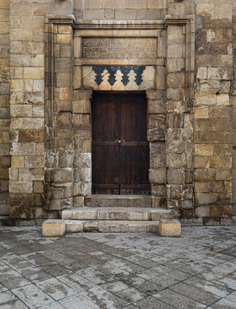 theological: Entrance of Madrasa of al-Salih was constructed by As-Saleh Nagm Ad-Din Ayyub in 1242-44, Old Cairo, Egypt. It marks the introduction of what became a basic Mamluk mausoleum formula: a tomb adjoining a theological school. Stock Photo