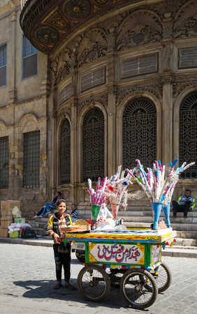 egypt: Local peddler selling lupinus on a handcart, Moez Street, Cairo, Egypt. One of the traditions of Egypt Editorial