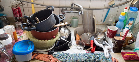 dishes: Pile of dirty utensils in a kitchen washbasin