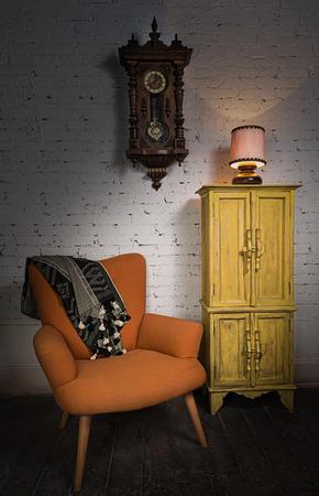 Still life of vintage orange armchair, yellow cupboard, wooden pendulum clock and illuminated table lamp on a wooden floor and white bricks wall