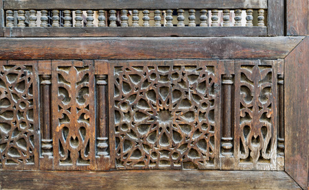 interleaved: Part of an interleaved wooden decorations (Arabisk) facade, Old house, Cairo, Egypt