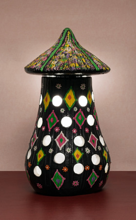 perforated: Illuminated black painted perforated pottery table lamp
