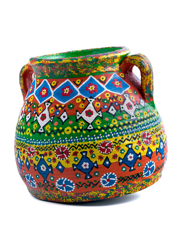 Colorful Egyptian handcrafted decorated artistic pottery jar on white background
