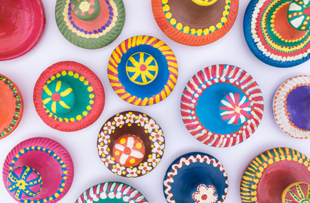 lids: Composition of painted handmade pottery lids on white background Stock Photo