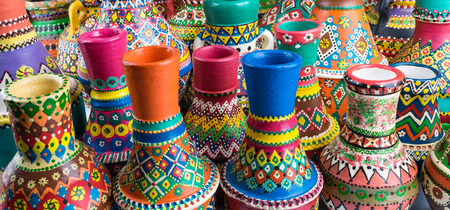 angled view: Angled view showing a composition of artistic painted handcrafted pottery vases Stock Photo