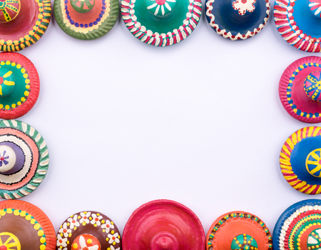 Frame Of Painted Colorful Pottery Lids On White Background Stock ...