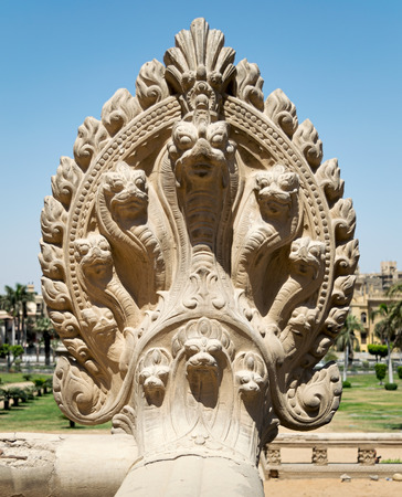 Hindu statue of snakes. One of the statues studding the terrace of the palace of Baron Empain, Cairo, Egypt