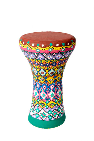 sou: Front view of one colorful painted goblet drum (also chalice drum, tarabuka, darbuka, debuka, doumbek, dumbec, dumbeg, dumbelek, toumperleki, or tablah), single head membranophone with a goblet shaped body used mostly in the Middle East, North Africa, Sou