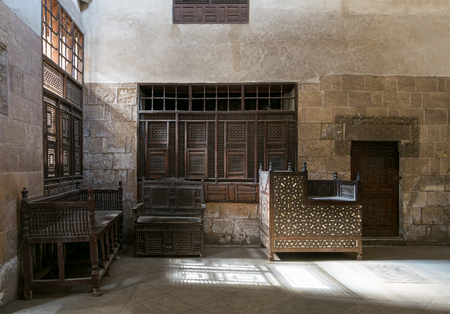 couches: One of the rooms of El Sehemy house, an old Ottoman era house in Cairo, originally built in 1648, with interleaved wooden windows (Mashrabiya) and arabisk wooden couches