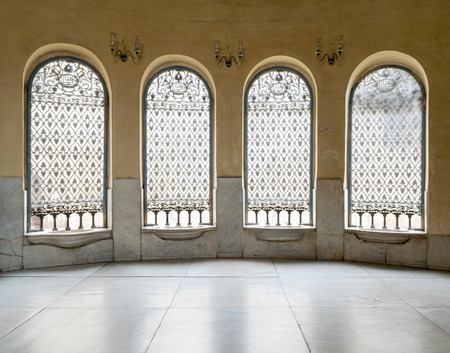 Space used to be a Sabil (Service providing free drinking water to pedestrians and animals) with Four windows with iron ornate grid, in a yellow painted wall and white marble floor, part of the mosque of Soliman Agha El-Selehdar, a historic mosque built
