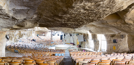 coptic orthodox: St. Samaan the Tanner Hall with walls decorated with artworks engraved on the rocks representing scenarios from the Bible,part of a huge cave discovered in 1974 in Saint Samaan The Tanner Monastery, and prepared later to contain the hall (accommodating 20 Stock Photo