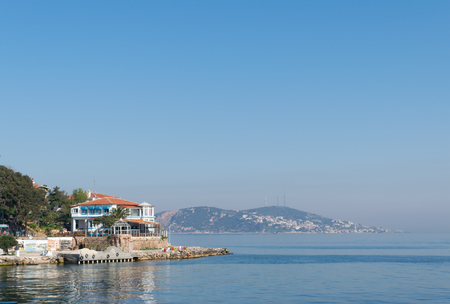 View of Burgazada island from the sea showing a summer house. The island is the third largest one of four islands named Princes Islands in the Sea of Marmara, near Istanbul, Turkey