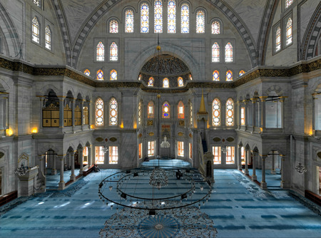 Istanbul, Turkey - April 20, 2017: Interior of Nuruosmaniye Mosque, an Ottoman Baroque style mosque completed in 1755, with a huge dome & many colored stained glass windows, Fatih, Istanbul, Turkey Editorial
