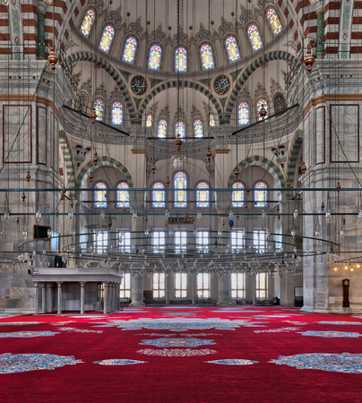 Istanbul, Turkey - April 25, 2017: Fatih Mosque, a public Ottoman mosque in the Fatih district of Istanbul, Turkey, with a huge decorated domes & many colored stained glass windows