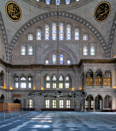 Interior facade of Nuruosmaniye Mosque, an Ottoman Baroque style mosque completed in 1755, with a huge arch & many colored stained glass windows located in Shemberlitash, Fatih, Istanbul, Turkey Editorial