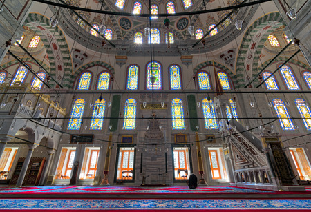Fatih Mosque, a public Ottoman mosque in the Fatih district of Istanbul, Turkey, with a huge decorated arches and many colored stained glass windows Editorial